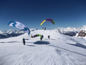 Skiing in Verbier - skiers and parachutes