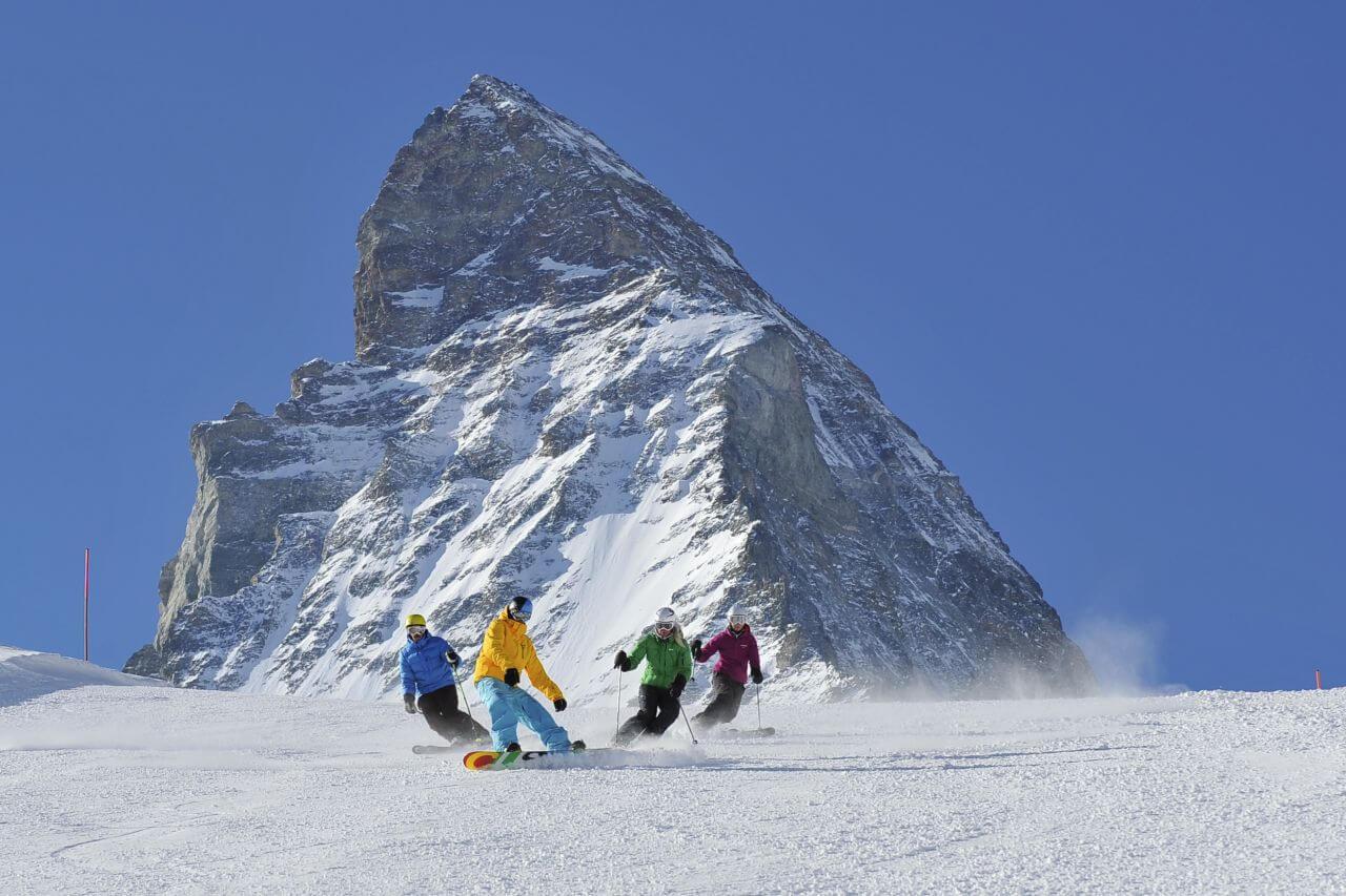 Zermatt - 4 skiers with Matterhorn behind-2
